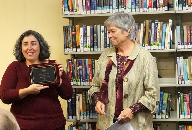 Susan Gaudiello, NHLTA President presents Library Trustee Chairperson Aimee Huntemann the award.
